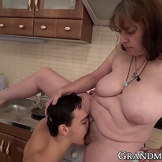 Granny in a pussy licking 69 with young cock gets jizz on tits